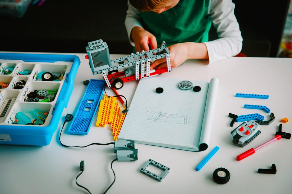 Child building a robot