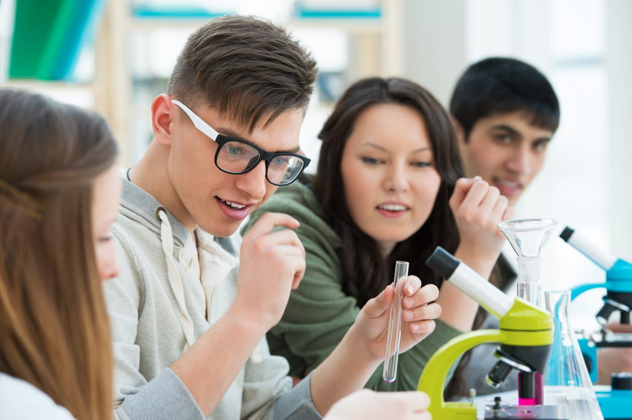 High School students. Group of students working together at laboratory class.