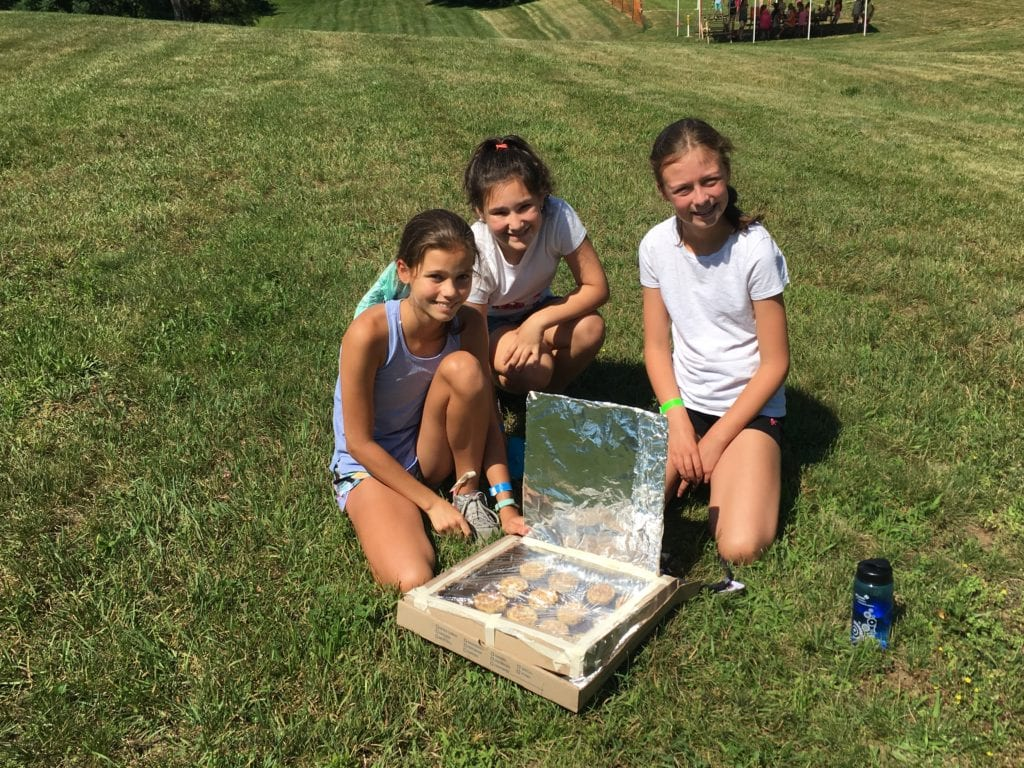 Girl Scouts use solar oven to bake cinnamon rolls