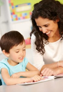 child and mom doing a workbook