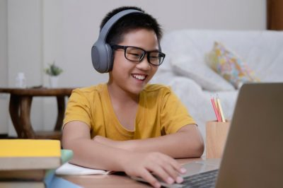 cheerful_boy_using_computer_for_online_instruction_1