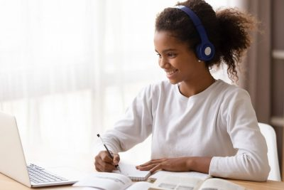 happy-teen-engaging-with-a-class-and-doing-work-on-her-laptop_1250x836_acf_cropped